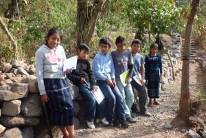Class 6 sitting on a newly made stone wall.